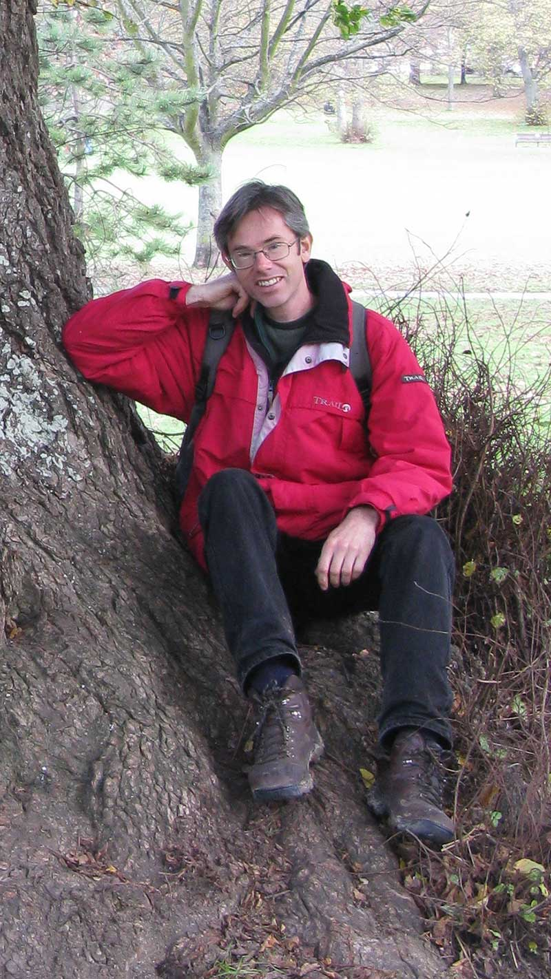 Dr Owen Johnson sat by an English Elm at Preston Park. Image ©Jeroen Heindijk.