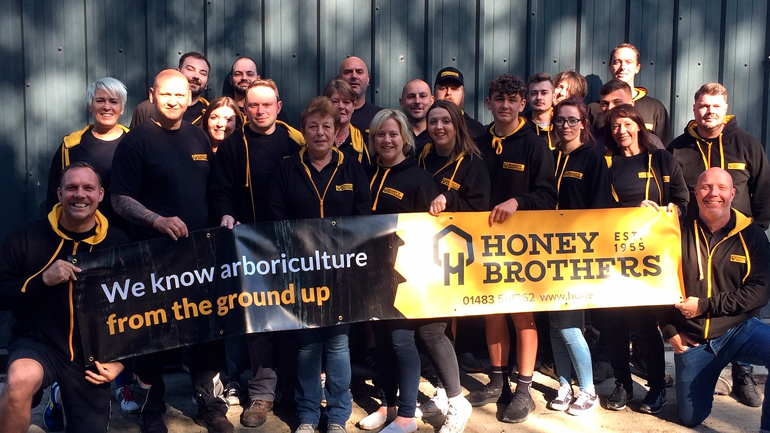 Honey Brothers staff proudly show off new branding