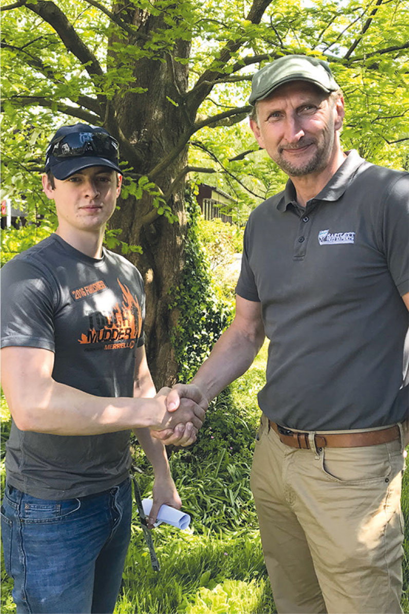 Myerscough College student James Blades (left) and Richard Trippett, UK and Ireland Division Manager of Bartlett Tree Experts.